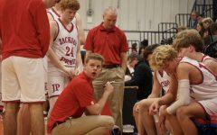 Coach Allison draws up plays for the Junior Varsity boys team.
