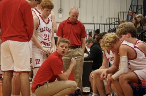 Coach Allison draws up plays for the Junior Varsity boys team.