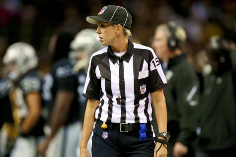Sarah Thomas officiates one of her many NFL football games. Photo courtesy of NFL