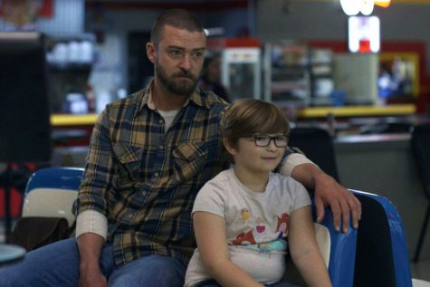 Justin Timberlake (left), as his character Eddie Palmer, sitting with Ryder Allen (right), as his character Sam.