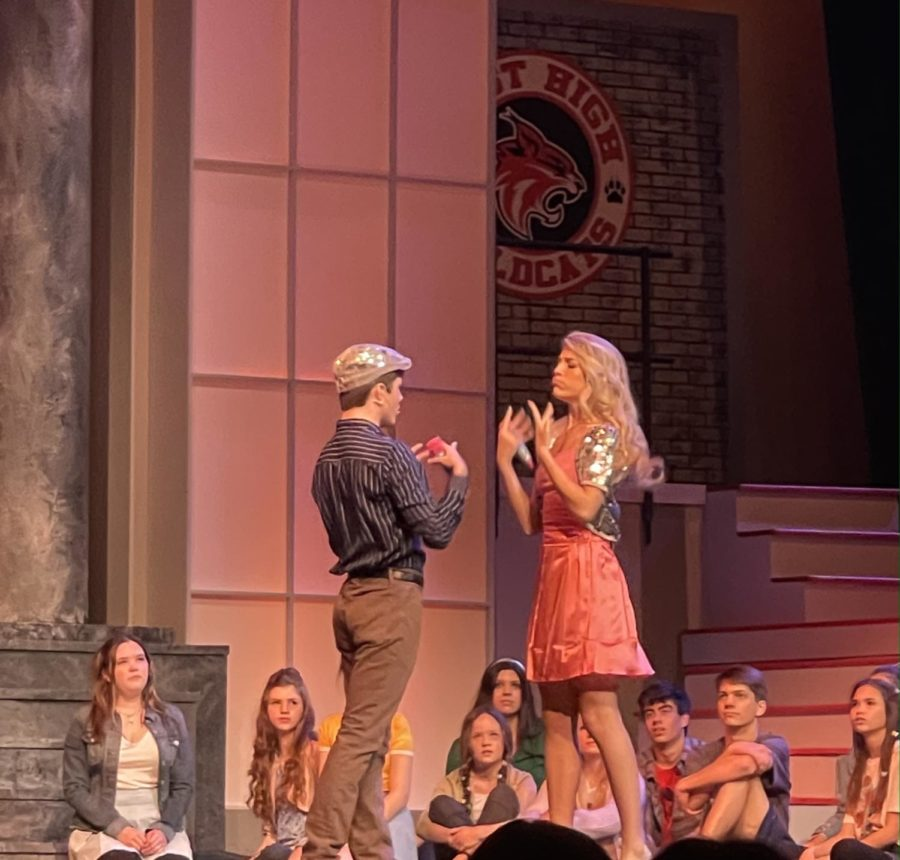 Ryan (Bradley Stafford) and Sharpay (Tori Johnston) warming up for their song.