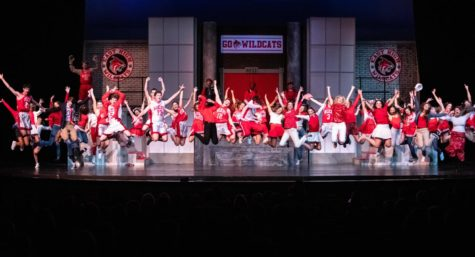 "The Prep cast of ""High School Musical"" leaps into the air."