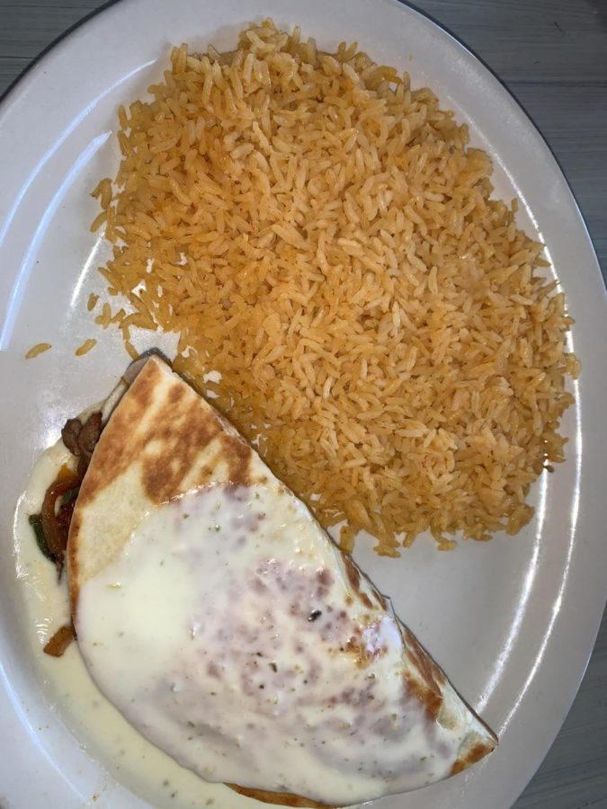 Delish quesadilla with a side of rice. Photo Credits from Hannah Polk