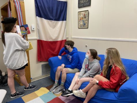 Haze Clayton, 9th, reading to Mason Deas(9th) Lilly Luckett(9th), Tyler Collins(10th) as they study French