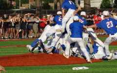The team rushes the field, creating a dog pile on top of Will Gibbs, the closing pitcher, after the final out of the championship series.