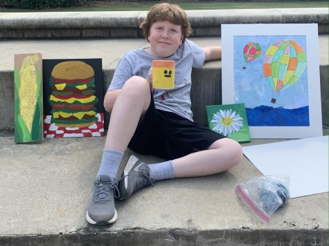 A Prep summer camper shows off a weeks worth of art.