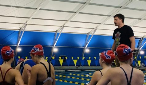 Coach Charles gives pointers to Prep swimmers.