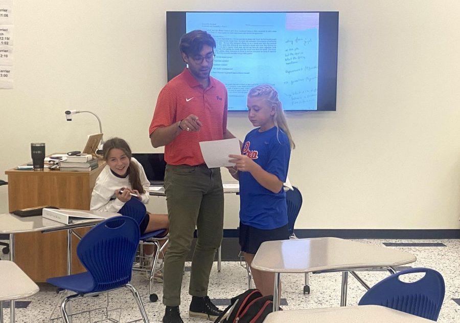 Mr. Chris Diethelm assists students.