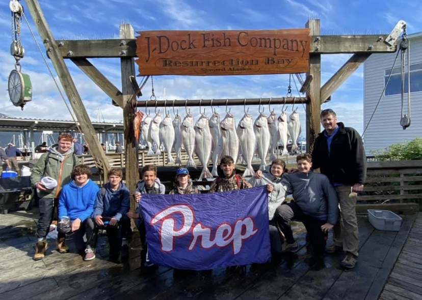 Alaskan adventurers pose with their catch.