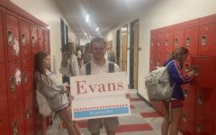 New president holds his campaign sign